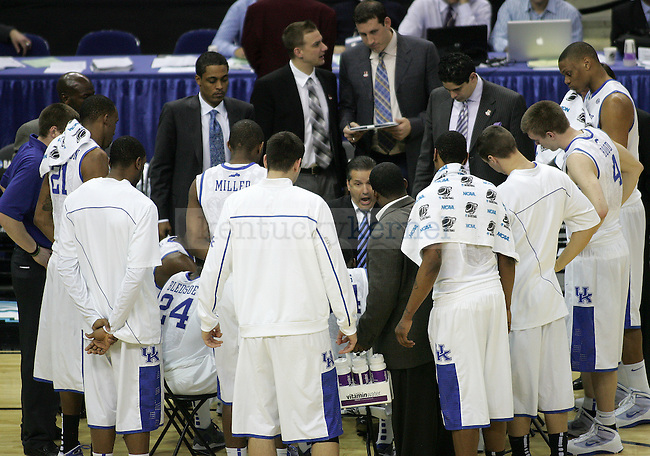 Head coach John Calipari huddles with his team for a timeout during the second half of the UK men's basketball against East Tennessee State for the first round of the NCAA tournament at New Orleans Arena on Thursday, March 18, 2010. The Cats won 100-71 over the Bucs. Photo by Adam Wolffbrandt | Staff