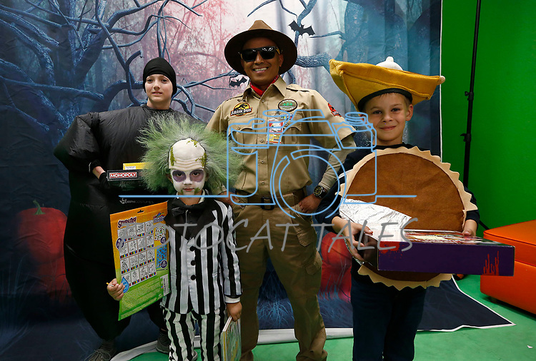 Winners of the annual costume contest, from left, Graham Zemke, 12, as a balloon, Bennett Aleman, 4, as Beetlejuice, Jake Boholst, as a Jurassic Park guide, and Christopher Strange, 8, as a pie, pose for photos after the Boo-nanza event at the Carson City Library, in Carson City, Nev., on Tuesday, Oct. 30, 2018. <br /> Photo by Cathleen Allison/Nevada Momentum
