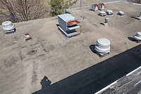 Roof Replacement and Mechanical Upgrades Stratford School For Aviation Maintenance Technicians.  Project No: BI-RT-860<br /> Contractor: Silktown Roofing, Manchester CT.<br /> James R Anderson Photography   New Haven CT   photog.com<br /> Date of Photograph: 13 April 2014<br /> Camera View: Northeast, Roof B   Image No. 26