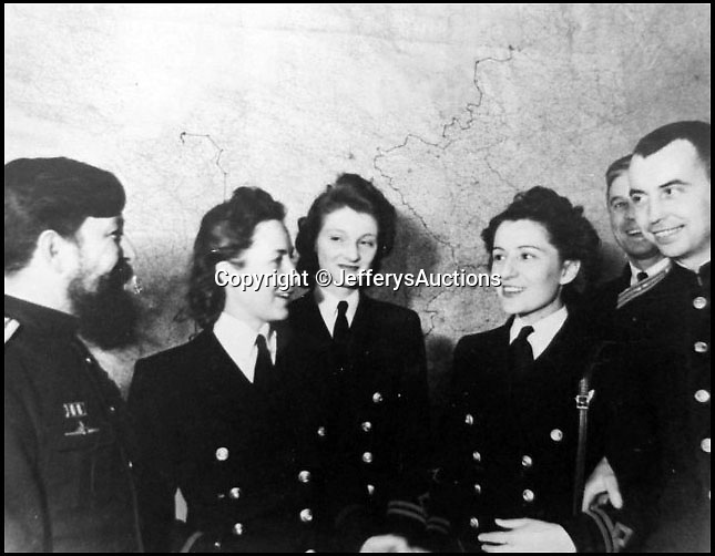 BNPS.co.uk (01202 558833)Pic:  JefferysAuctions/BNPS                               <br /> <br /> <br /> <br /> Remarkable never before seen photos have emerged which reveal what went on in Sir Winston Churchill's War Rooms.<br /> <br /> The candid snaps provide a fascinating glimpse into life inside the iconic bunker where the crucial decisions were taken which won the Second World War.<br /> <br /> In total, there are 27 photos in the album which belonged to photographer Noel Richards, a long serving employee at the War Office.<br /> <br /> He photographed daily the maps in the War Rooms and was granted unprecedented access to Churchill and his inner circle.