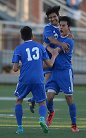 NWA Democrat-Gazette/ANDY SHUPE<br /> Rogers senior Willie Hernandez (right) yells Tuesday, April 10, 2018, after scoring a goal while celebrating with senior Johan Rodriguez (top) and junior Felix Escobar during the second half against Springdale at Jarrell Williams Bulldog Stadium in Springdale. Visit nwadg.com/photos to see more photographs from the match.