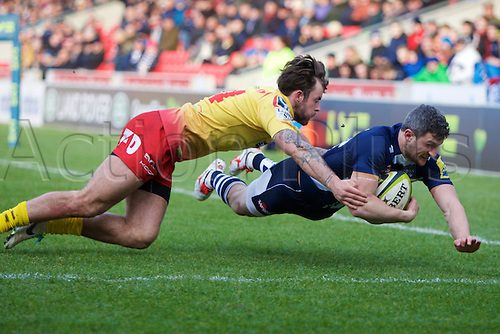 07.02.2015.  Sale, England.  LV Cup Rugby. Sale Sharks versus Scarlets. Sale Sharks wing Tom Brady scores a try.