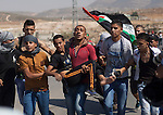 Palestinians evacuating to a young injured by israeli army during clashes after a demonstration in Nablus. The palestinians claim the end of the israeli occupation in the West Bank.