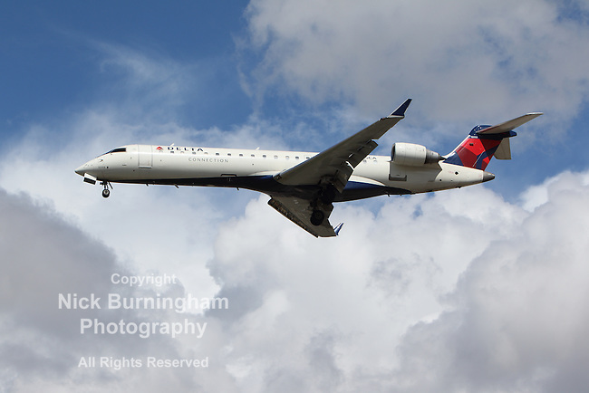 LOS ANGELES, CALIFORNIA, USA - MARCH 8, 2013 - Delta Connection Bombardier CRJ-701 lands at Los Angeles Airport on March 8, 2013. The plane has a range of 2,656 km with 66 seats.