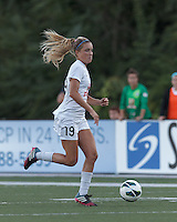 FC Kansas City midfielder Kristie Mewis (19) on the attack.  In a National Women's Soccer League (NWSL) match, Boston Breakers (blue) defeated FC Kansas City (white), 1-0, at Dilboy Stadium on August 10, 2013.