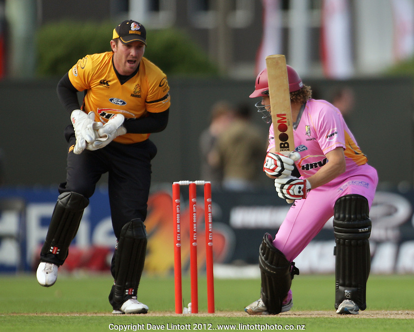 Wellington keeper Brendan Taylor and Knights batsman Hamish Marshall during the HRV Cup Twenty20 cricket match between Wellington Firebirds v Northern Knights at Hawkins Finance Basin Reserve, Wellington. Wednesday, 11 January 2012. Photo: Dave Lintott / lintottphoto.co.nz
