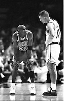 Chicago Bull's Michael Jordan witrh Golden State Warrior Chris Mullen. (photo by Ron Riesterer/photoshelter)