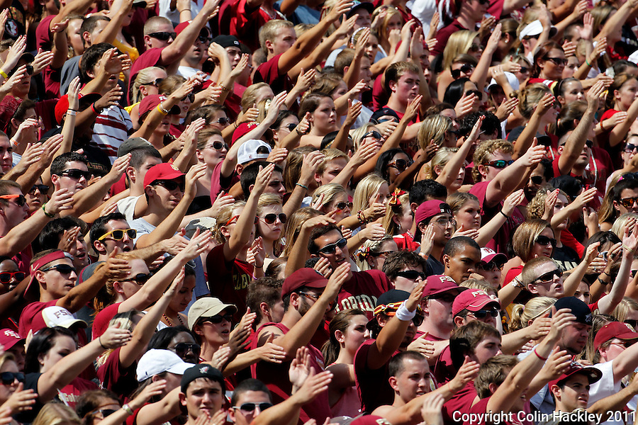 TALLAHASSEE, FL 9/3/11-FSU-ULM FB090311 CH-Florida State fans do the chop during the University of Louisiana at Monroe game Saturday at Doak Campbell Stadium in Tallahassee. .COLIN HACKLEY PHOTO