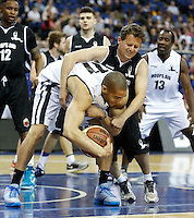 Oguchi Onyewu US Soccer Player holds onto the ball under pressure from Newsreader Mike Bushell during Hoops Aid 2015 Celebrity AllStars Basketball Match at the o2 Arena, London, England on 10 May 2015. Photo by Andy Rowland.