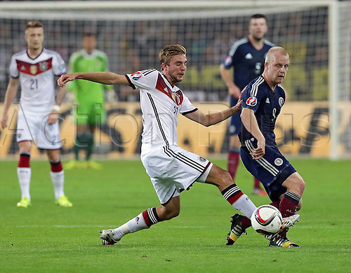 07.09.2014. Dortmund, Germany.   international match Germany Scotland  in Signal Iduna Park in Dortmund. Christoph Kramer Germany is turned by Steven Naismith Scotland