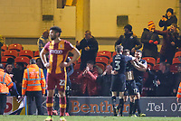 Michael Jacobs is congratulated by his team mates during the Sky Bet League 1 match between Bradford City and Wigan Athletic at the Northern Commercial Stadium, Bradford, England on 14 March 2018. Photo by Thomas Gadd.