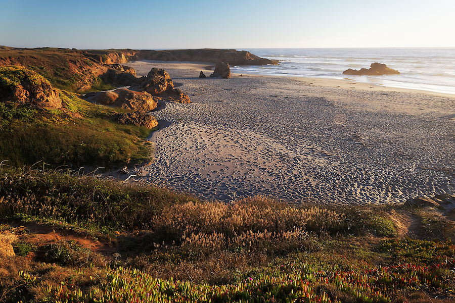 Sandy beach and bluffs at sunset, MacKerricher State Park, Fort Bragg, Mendocino County, California, USA