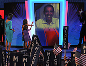 Denver, CO - August 25, 2008 -- Michelle Obama, and her daughters,  Malia Ann, and Sasha, wave to United States Senator Barak Obama (Democrat of Illinois) who appeared via a video link-up after Michelle delivered remarks as the prime-time speaker on day 1 of the 2008 Democratic National Convention at the Pepsi Center in Denver, Colorado on Monday, August 25, 2008..Credit: Ron Sachs - CNP.(RESTRICTION: NO New York or New Jersey Newspapers or newspapers within a 75 mile radius of New York City)