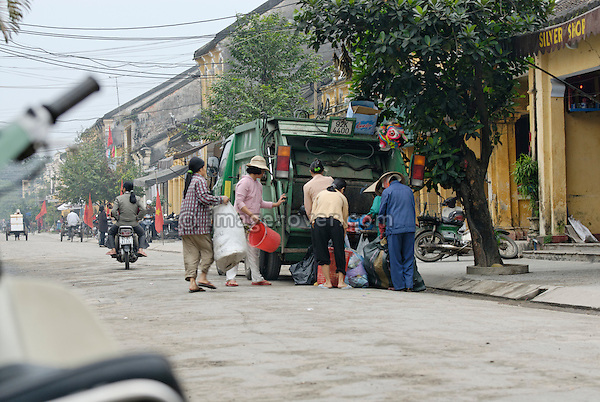 Asia, Vietnam, Hoi An. Hoi An old quarter nr. central market. Waste collection. The historic buildings, attractive tube houses, and decorated community halls have 1999 earned Hoi An's old quarter the status of a UNESCO World Heritage Site. To protect the old quarter's character stringent conversation laws prohibit alterations to buildings, as well as the presence of cars on the roads.