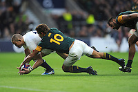 Mike Brown of England attempts to collect the ball, which ends to Courtney Lawes' try, as Pat Lambie of South Africa stops him during the Old Mutual Wealth Series match between England and South Africa at Twickenham Stadium on Saturday 12th November 2016 (Photo by Rob Munro)