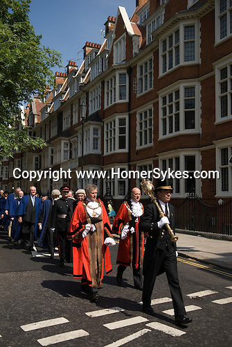 The annual civic service, St Mary Abbots, Kensington Parish church. The Royal Borough of Kensington and Chelsea London W8. England. 2006. The new Mayor Councillor Tim Ahern, and deputy Mayor Robert Freeman, and  newly elected councillors in blue robes process to the church.
