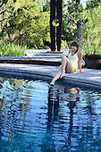 Stock photo of a woman in a pool amd spa setting