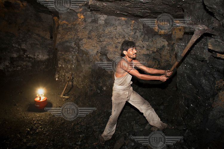 A miner works underground in a small non-mechanized coal mine. In the wake of displacement by large scale, government backed, open pit mining, the economy of Jharkhand is changing as many smaller artisanal (and usually illegal) mines have been dug by villagers who were formerly farmers in order to make a living.