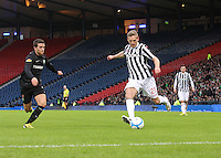 Gary Teale crossing before being challenged by Adam Matthews in the St Mirren v Celtic Scottish Communities League Cup Semi Final match played at Hampden Park, Glasgow on 27.1.13.