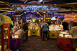 People playing on machines, Electric Palace amusement arcade, Weymouth, Dorset, England