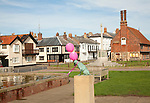 Balloons tied to famous Snook's dog statue, Aldeburgh, Suffolk, England