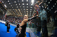 (Center) Fabrizia D'Ottavio of Italian group smiles to cameras after 2008 European Championships at Torino, Italy on June 7, 2008.  Photo by Tom Theobald.