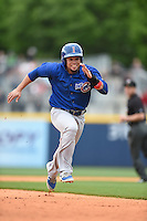 ***Temporary Unedited Reference File***Iowa Cubs left fielder Juan Perez (5) during a game against the Nashville Sounds on May 4, 2016 at First Tennessee Park in Nashville, Tennessee.  Iowa defeated Nashville 8-4.  (Mike Janes/Four Seam Images)