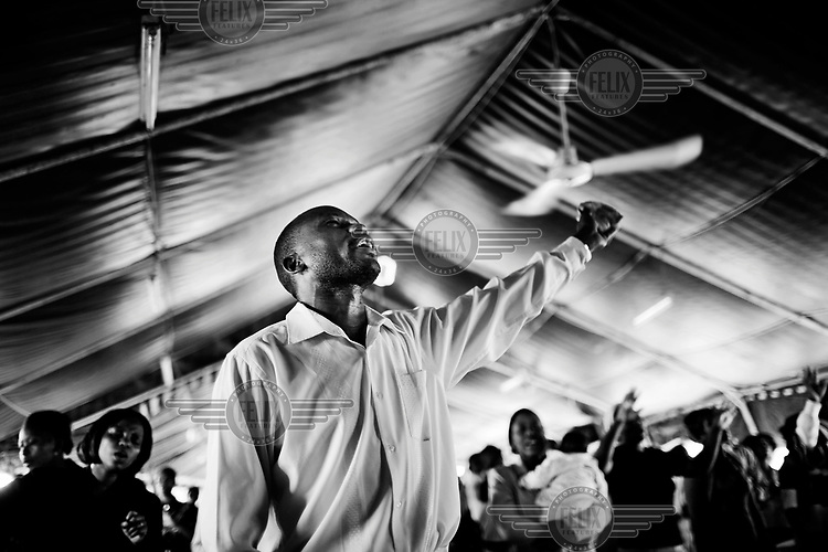 Pastor Richard Ouya in the Cathedral of Praise Ministry Church in Kibera.