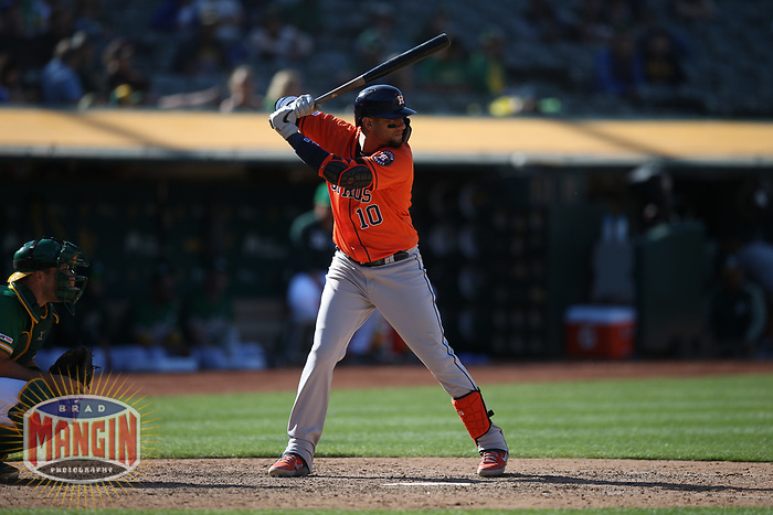 OAKLAND, CA - JUNE 2:  Yuli Gurriel #10 of the Houston Astros bats against the Oakland Athletics during the game at the Oakland Coliseum on Sunday, June 2, 2019 in Oakland, California. (Photo by Brad Mangin)