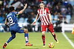 Getafe's Damian Suarez (l) and Atletico de Madrid's Filipe Luis during La Liga match. February 14,2016. (ALTERPHOTOS/Acero)
