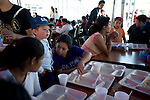 Residents in San Marcos receive lunch at government's emergency relief rent in San Marcos 3 days  a 7.4 earthquake struck Guatemala.