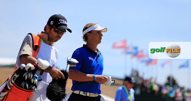 Joost LUITEN (NED) and caddy Jannie walk off the 1st tee to start his match during Saturday's Round 3 of the 2015 U.S. Open 115th National Championship held at Chambers Bay, Seattle, Washington, USA. 6/20/2015.<br /> Picture: Golffile | Eoin Clarke<br /> <br /> <br /> <br /> <br /> All photo usage must carry mandatory copyright credit (&copy; Golffile | Eoin Clarke)