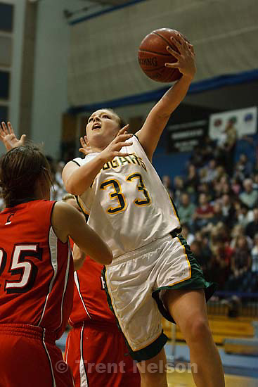 Taylorsville - Kearns' Brooke Larsen (33) shoots. American Fork vs. Kearns High School girls basketball, 5A State Championship tournament Thursday February 26, 2009 at Salt Lake Community College.