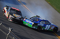 Apr 26, 2009; Talladega, AL, USA; NASCAR Sprint Cup Series driver Brad Keselowski (09) makes contact with Carl Edwards (99) on the last lap during the Aarons 499 at Talladega Superspeedway. Mandatory Credit: Mark J. Rebilas-