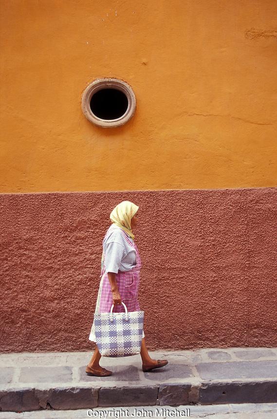 Mexican woman carrying a shopping bag in San Miguel de Allende, Mexico