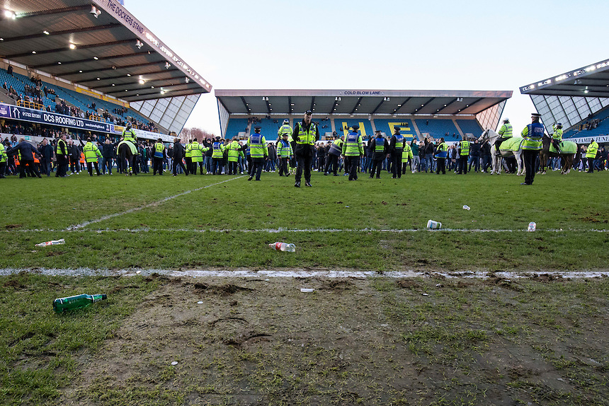 Debris of coins and bottles are seen on the pitch having been thrown onto the field after Millwall fans staged a pitch invasion at full time<br /> <br /> Photographer Craig Mercer/CameraSport<br /> <br /> Emirates FA Cup Fifth Round - Millwall v Leicester City - Saturday 18th February 2017 - The Den - London<br />  <br /> World Copyright &copy; 2017 CameraSport. All rights reserved. 43 Linden Ave. Countesthorpe. Leicester. England. LE8 5PG - Tel: +44 (0) 116 277 4147 - admin@camerasport.com - www.camerasport.com