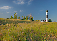 Big Sable Lighthouse sits among the foredune grasses in Ludington State Park in Michigan