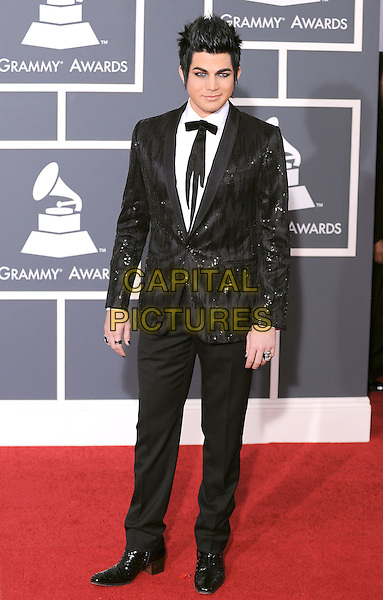 ADAM LAMBERT.Arrivals at the 52nd Annual GRAMMY Awards held at The Staples Center in Los Angeles, California, USA..January 31st, 2010.grammys full length black suit.CAP/RKE/DVS.©DVS/RockinExposures/Capital Pictures