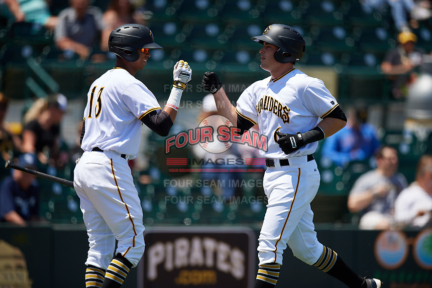 Bradenton Marauders right fielder Kevin Krause (6) is congratulated by Alfredo Reyes (13) after hitting a home run in the bottom of the second inning during a game against the Charlotte Stone Crabs on April 9, 2017 at LECOM Park in Bradenton, Florida.  Bradenton defeated Charlotte 5-0.  (Mike Janes/Four Seam Images)