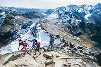 Two women hiking to the summit of the Piz Languard while trail running above Pontresina, Switzerland