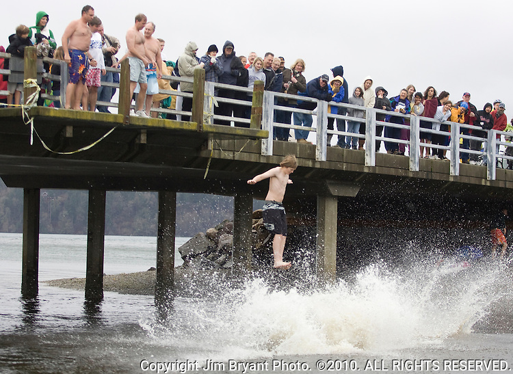 A jumper is about to hit the icy water while participating in the 25th annual Polar Bear jump into the Burley Lagoon in Olalla, Washington on January 1, 2009. Jim Bryant Photo. ©2010. ALL RIGHTS RESERVED.
