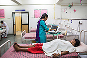 Dr. Sharon Cynthia checks the movement of the baby using a Cardio Tocogram in the maternity ward of the Duncan Hospital in Raxaul, Bihar, India.