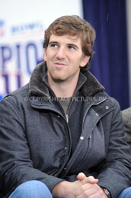 WWW.ACEPIXS.COM . . . . . ....February 5 2008, New York City....Quarterback Eli Manning....The New York Giants have a 'ticker-tape' parade in downtown Manhattan to celebrate their win in the 2008 Superbowl.....Please byline: KRISTIN CALLAHAN - ACEPIXS.COM.. . . . . . ..Ace Pictures, Inc:  ..(646) 769 0430..e-mail: info@acepixs.com..web: http://www.acepixs.com