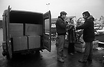 Ullapool Scotland. 1986.  Bulgarians with a van full of heaters and other goods that will be loaded onto the factory fishing boat and taken home.