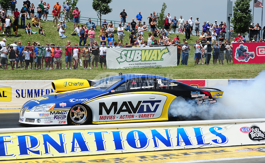 May 19, 2012; Topeka, KS, USA: NHRA pro stock driver Rodger Brogdon during qualifying for the Summer Nationals at Heartland Park Topeka. Mandatory Credit: Mark J. Rebilas-
