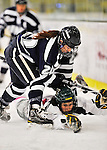 29 January 2012: University of New Hampshire Wildcat forward Emma Clark, a Senior from East Barre, VT, skates over a fallen University of Vermont Catamount forward Amanda Pelkey, a Freshman from Montpelier, VT, at Gutterson Fieldhouse in Burlington, Vermont. The Lady Cats edged out the Lady Wildcats 2-1 to split their Hockey East twin-game weekend series. Mandatory Credit: Ed Wolfstein Photo