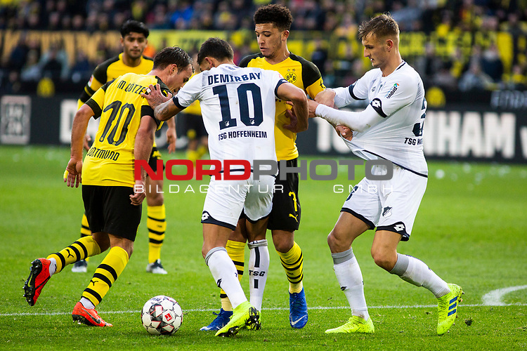 09.02.2019, Signal Iduna Park, Dortmund, GER, 1.FBL, Borussia Dortmund vs TSG 1899 Hoffenheim, DFL REGULATIONS PROHIBIT ANY USE OF PHOTOGRAPHS AS IMAGE SEQUENCES AND/OR QUASI-VIDEO<br /> <br /> im Bild | picture shows:<br /> Mario Goetze (Borussia Dortmund #10) und Jadon Sancho (Borussia Dortmund #7) im Duell mit Kerem Demirbay (Hoffenheim #10),  <br /> <br /> Foto © nordphoto / Rauch