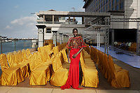 LAGOS, NIGERIA – DECEMBER 5: Cynthia Abdulahi, winner of Nigeria's Next Super Model 2013, fits a dress during a fitting before Africa International Fashion Week in the Lagos Oriental Hotel, Nigeria 2014<br /> (Photo by: Per-Anders Pettersson)
