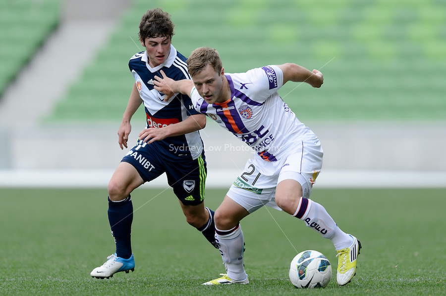 MELBOURNE - 19 September: Scott JAMIESON of the Glory holds off Marco ROJAS of the Victory at a pre-season match between Melbourne Victory and Perth Glory at AAMI Stadium on 19 September 2012. (Photo by Sydney Low / syd-low.com)