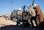 Wildcat wireline contractors remove a fracking device from an oil well on a Goodrich Oil Co field  on the Burns Ranch near Dilley, Texas on Tuesday, January 3, 2012...Ben Sklar